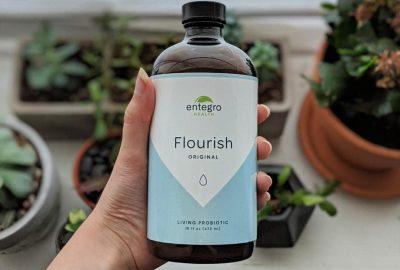 Bottle of Flourish over plants