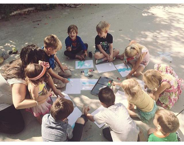 homeschooling co op five in a row children painting pictures on pavement