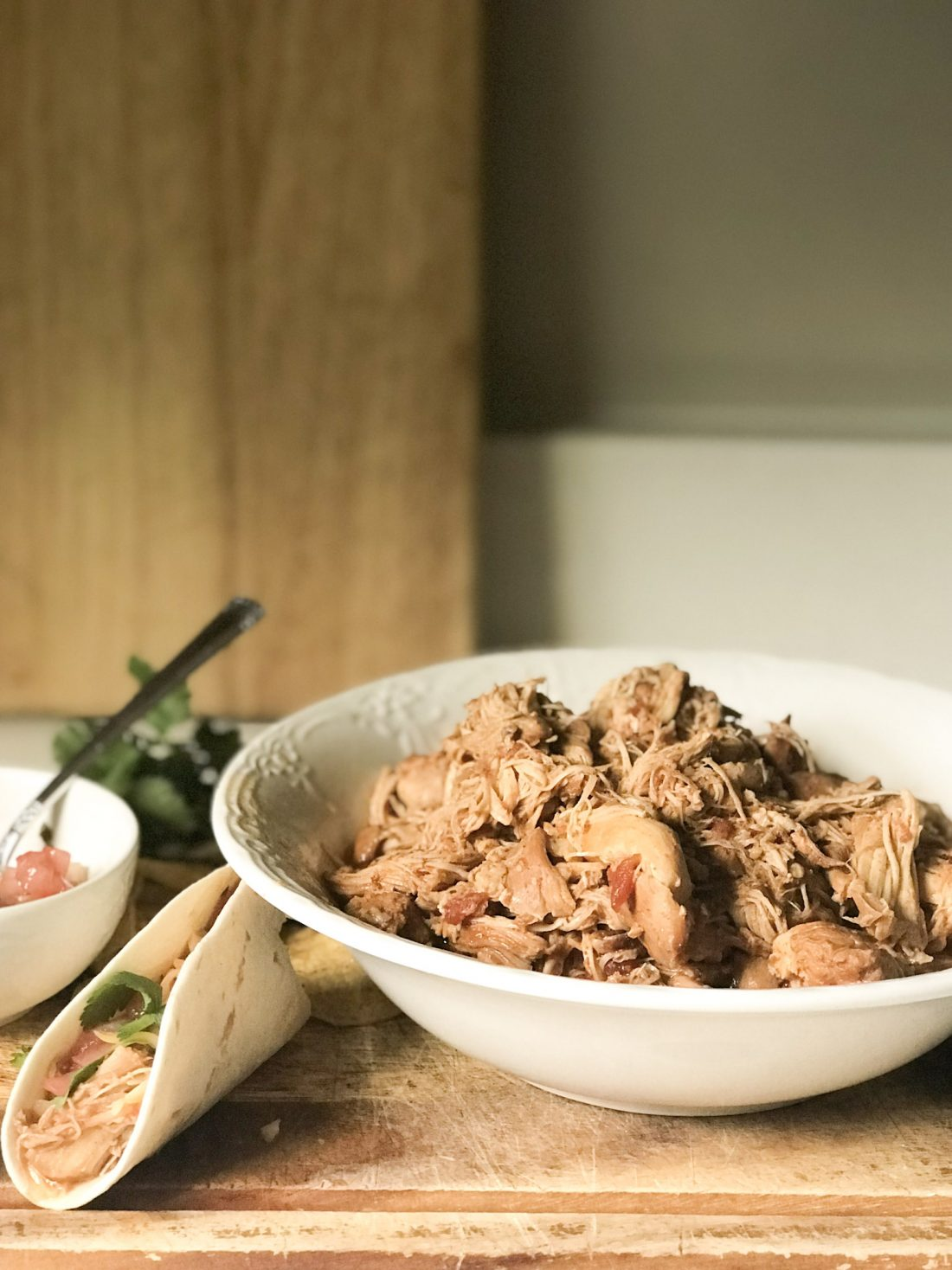 simple instant pot shredded Mexican chicken in bowl on kitchen counter