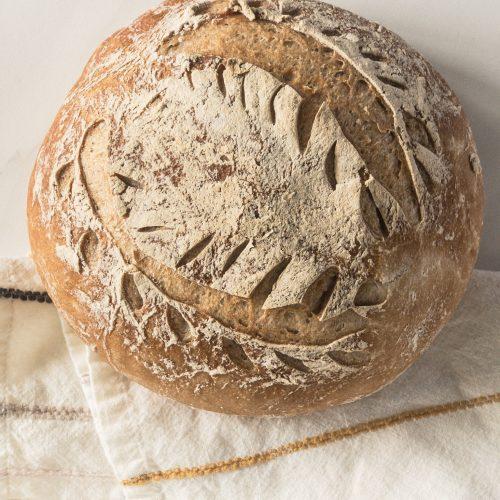 Gluten free sourdough bread loaf on napkin