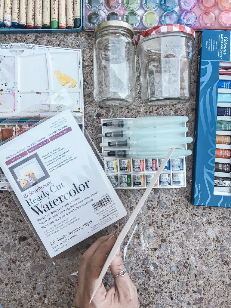 watercolor pages above supplies on sidewalk