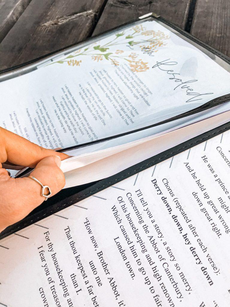 hymn lyrics stacked inside of morning menus