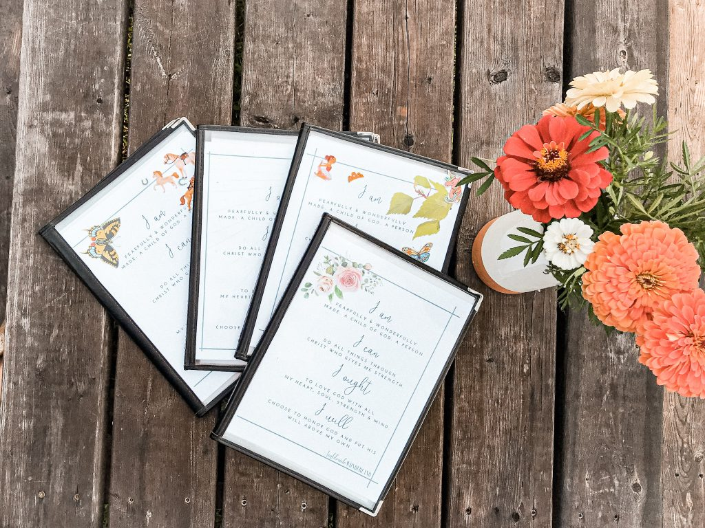 morning time menus laid on picnic table with flowers